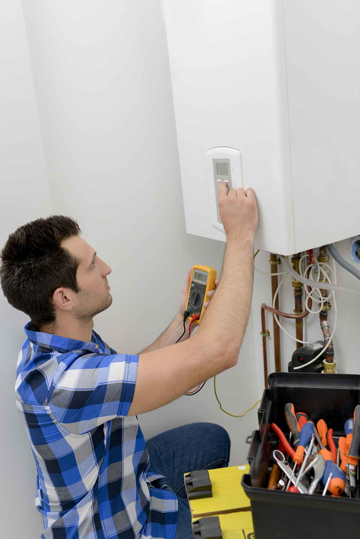 Fixing a boiler with ADHS Heating Supplies London Essex and Hertfordshire